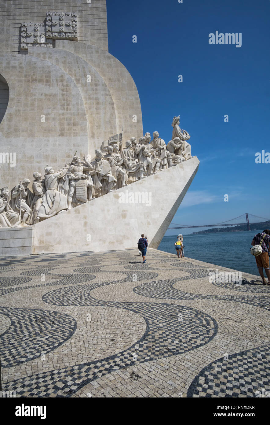 LISBON, PORTUGAL - August 30, 2018: Monument to the Discoveries (Padrao dos Descobrimentos) at the Tagus river with view on 25th of April Bridge Stock Photo