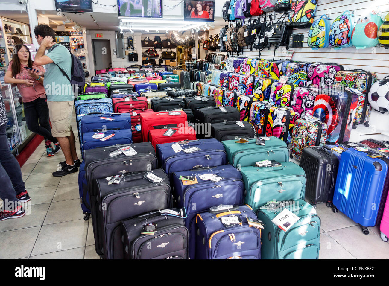 Miami Beach Florida Lincoln Road luggage suitcases display sale store inside business - Stock Image