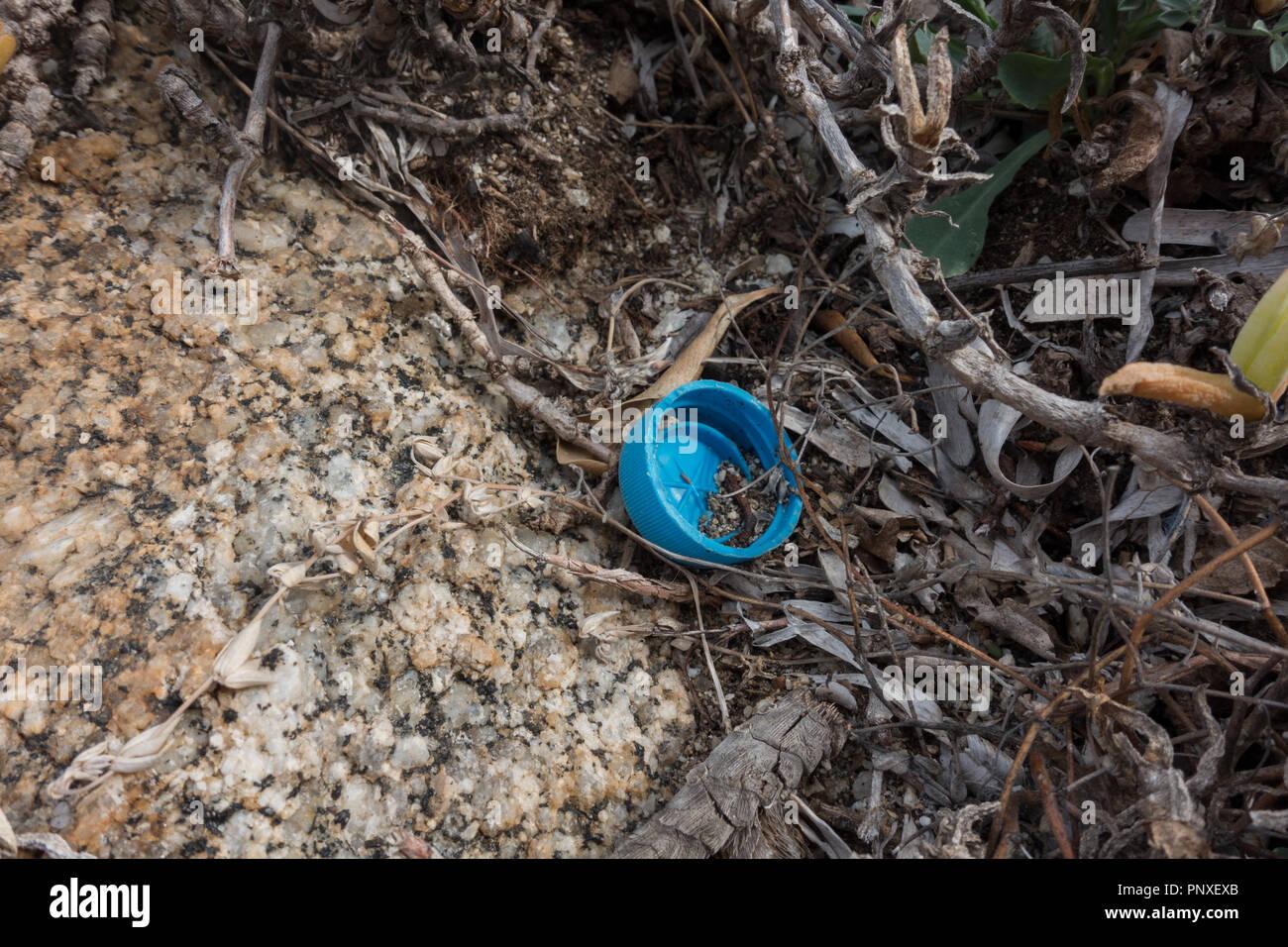 Plastic bottle top on seashore. Sardinia, Italy - Stock Image
