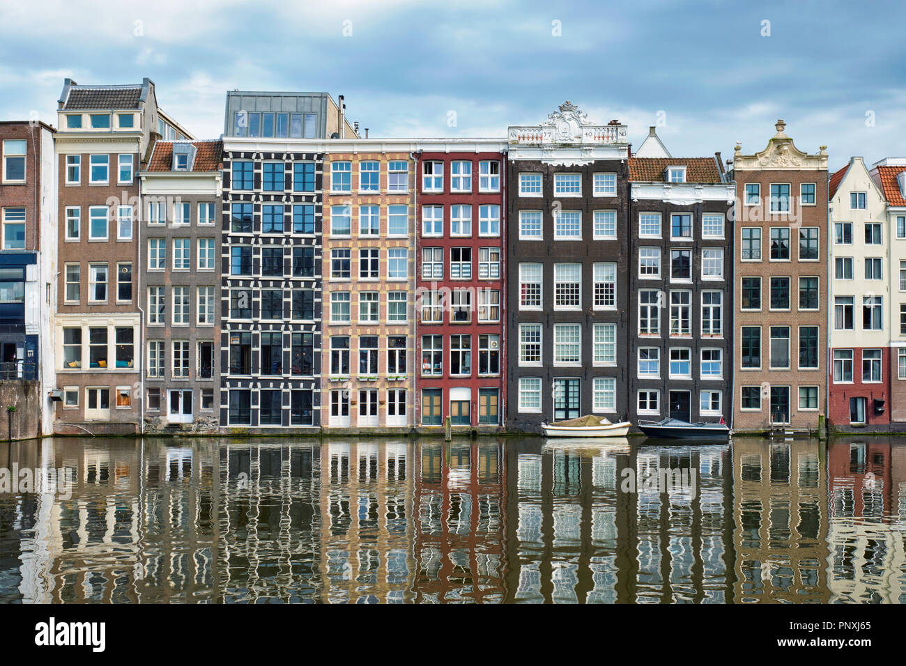 Amsterdam canal Damrak with houses, Netherlands - Stock Image