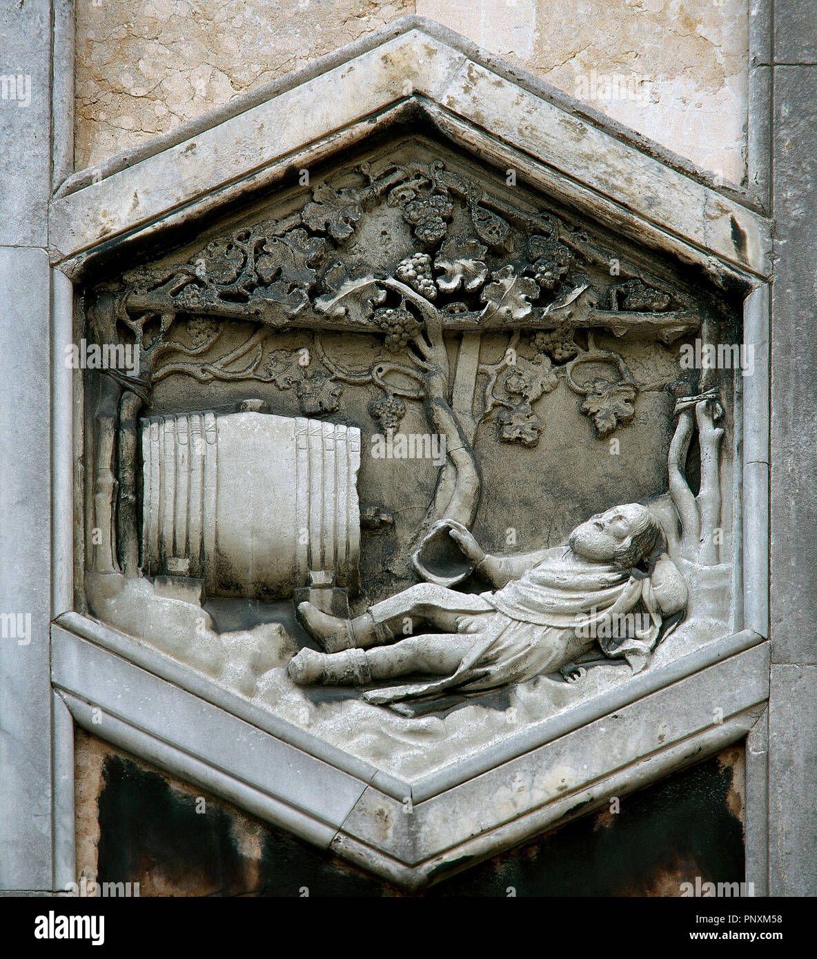 Noah. Pre-Flood Patriarchs. Relief depicting Noah drunk. Collaborator of Andrea Pisano (Master of Noah), 1334-1336. Reproduction of one of the panels that decorate the bell tower of the Duomo (the originals are located in the Museo della Opera del Duomo). Florence, Tuscany, Italy. Stock Photo