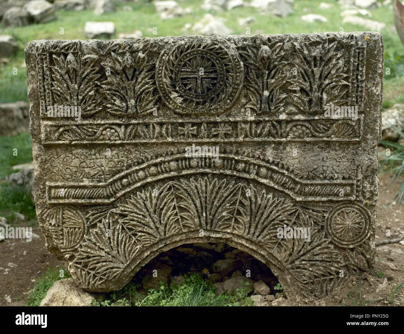 Basilica of Saint Simeon Stylites. 5th century. Sculptural detail. Relief. Cross. Near Aleppo. Syria. - Stock Image