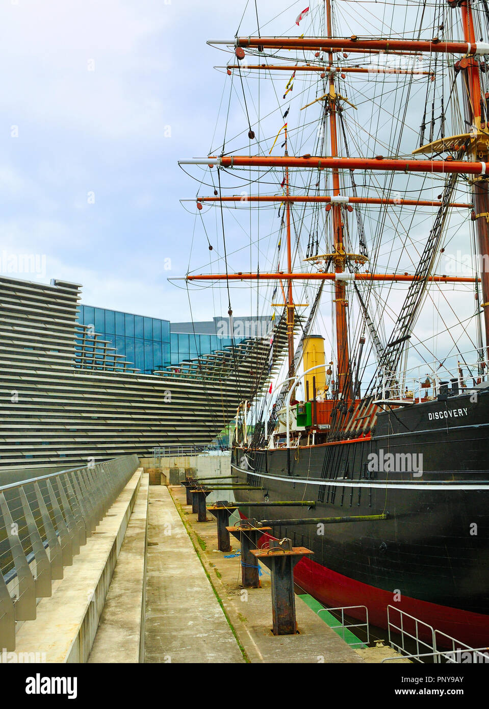 RRS Discovery research ship alongside the V & A Museum, Dundee Waterfront, Scotland Stock Photo