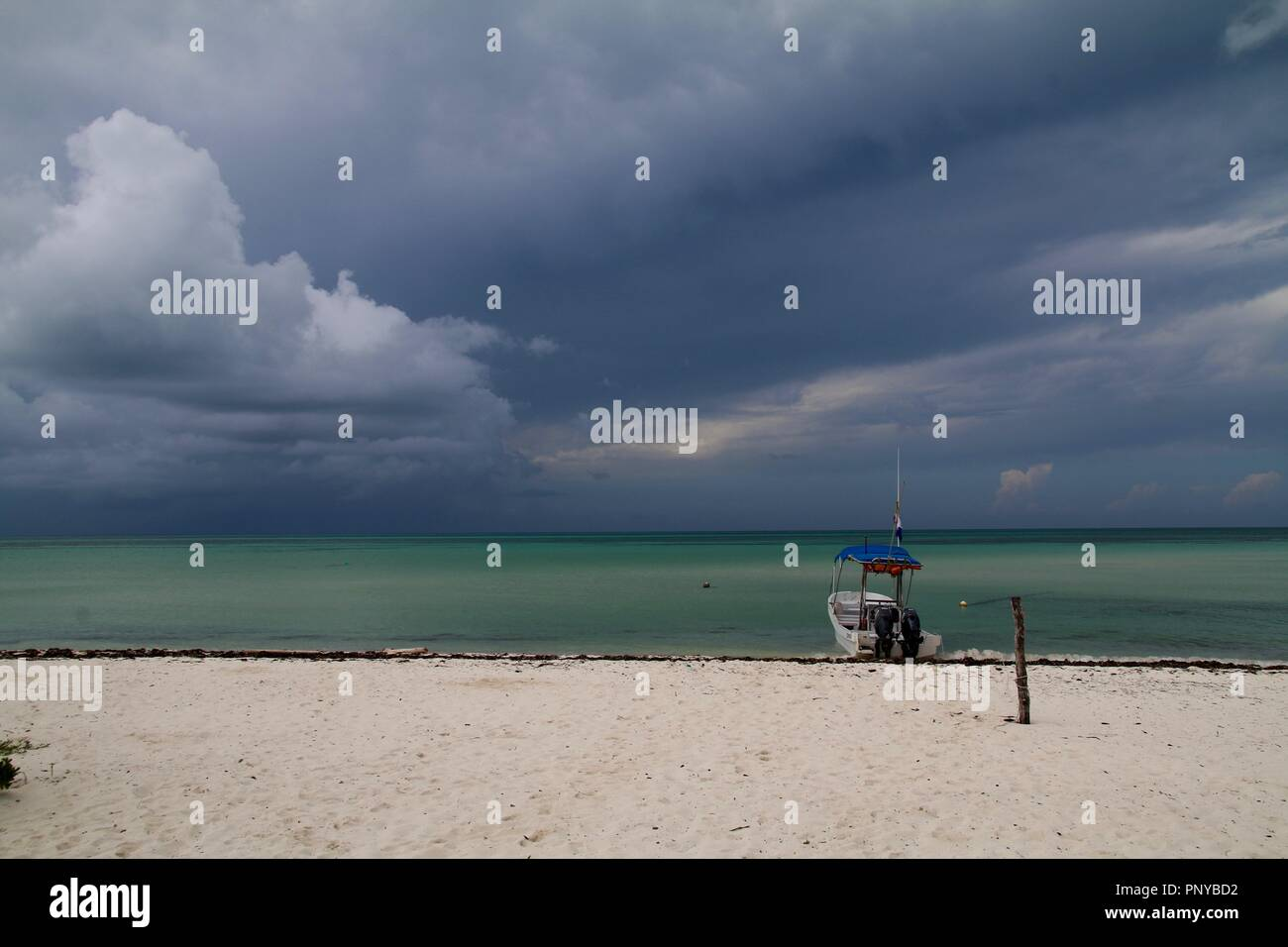 Dark tropical storm clouds forming and building in the Caribbean off  Cozumel island in Mexico