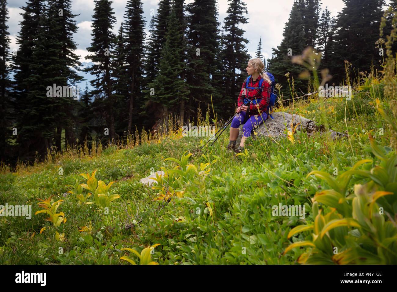 1d7cf972ff8d Girl enjoying the beautiful nature during a vibrant cloudy summer day.  Taken in Garibaldi Provincial Park