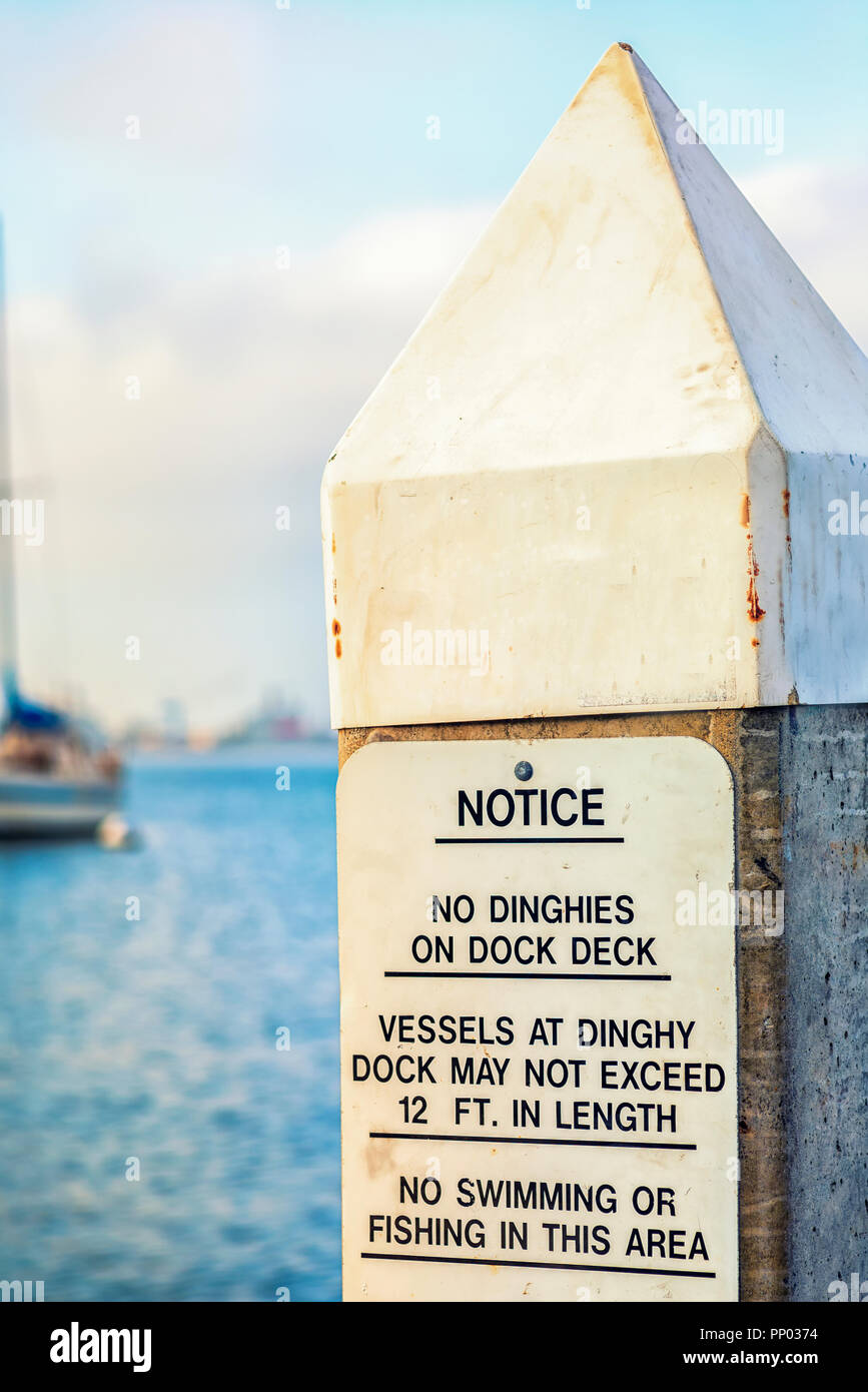 San Diego Harbor, California, USA. Sign with text with rules for conduct in a harbor setting. - Stock Image
