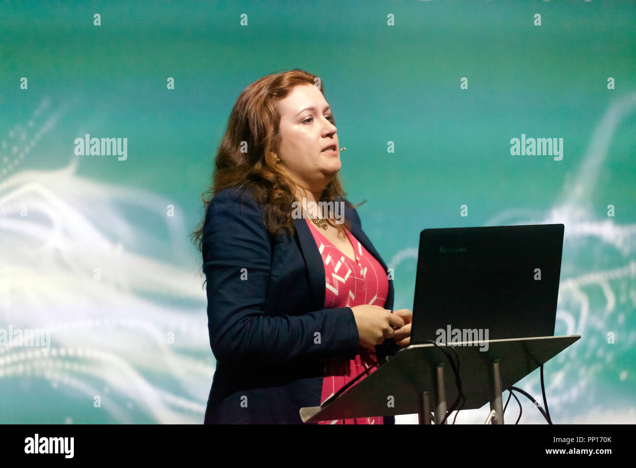 AI researcher  Beth Singler, explaining about what machines can tell us about being human, on the Technology Stage, at New Scientist Live - Stock Image