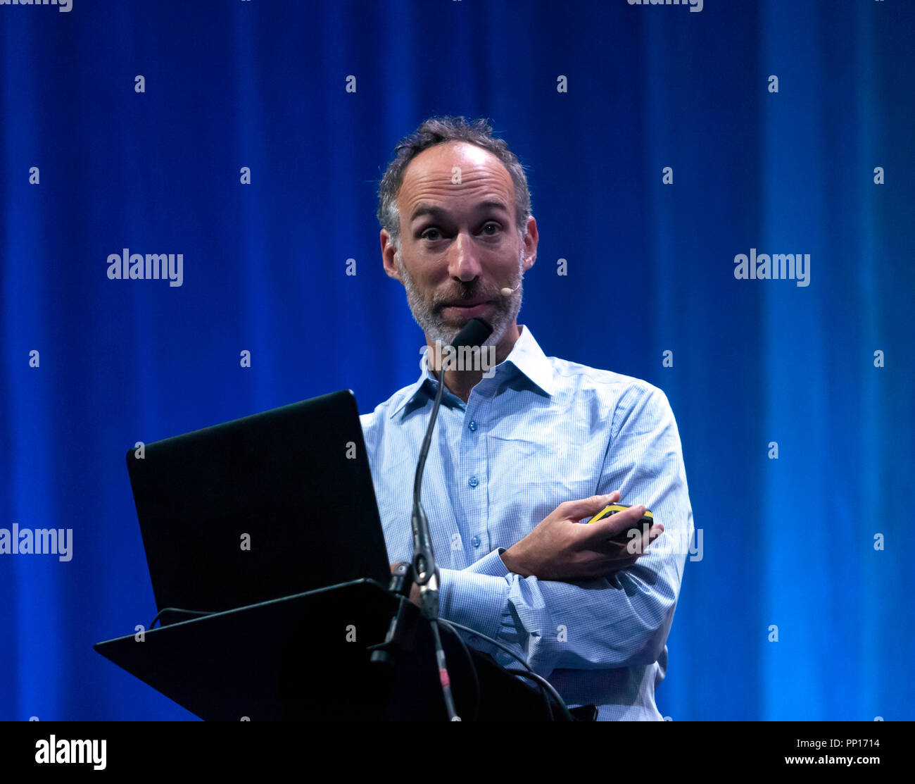 Geneticist David Reich explaining how ancient human DNA is providing suprising answers to the basic question of who we are and where we came from. on the Main Stage, at New Scientist Live Stock Photo