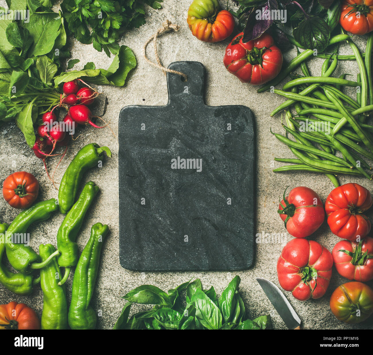 Healthy food background with seasonal vegetables and greens, copy space - Stock Image