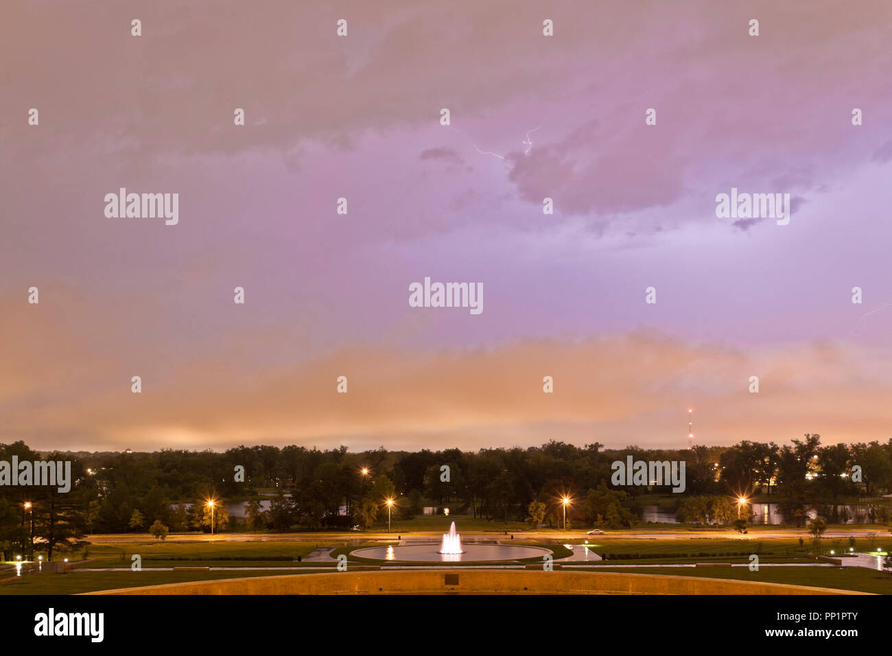Watching a strong thunderstorm pass over from the shelter of the World's Fair Pavilion at St. Louis Forest Park under a sky with striking pannus cloud - Stock Image