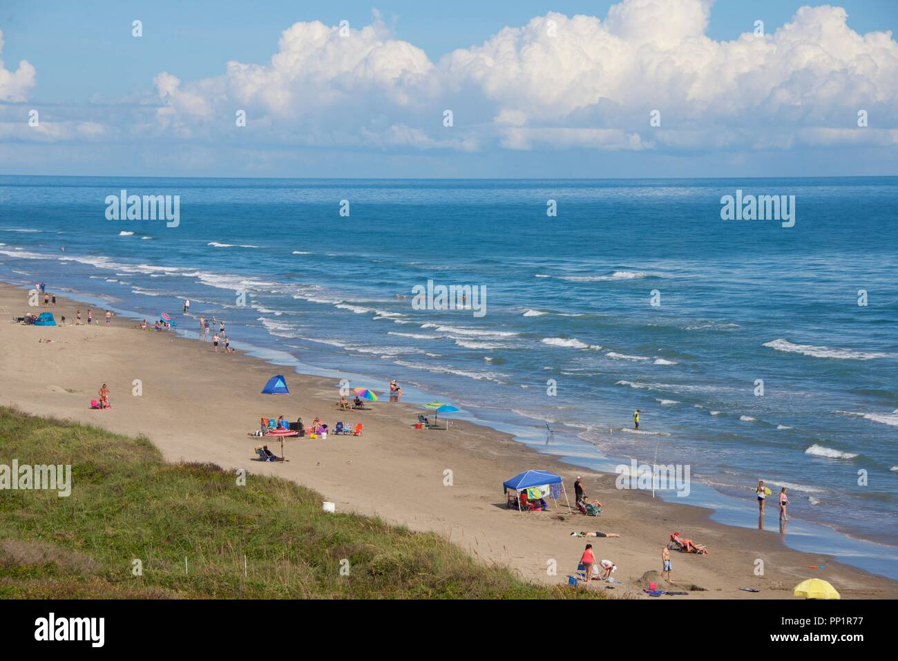 Beach-goers enjoy warm weather in November in South Padre Island, Texas -  Stock