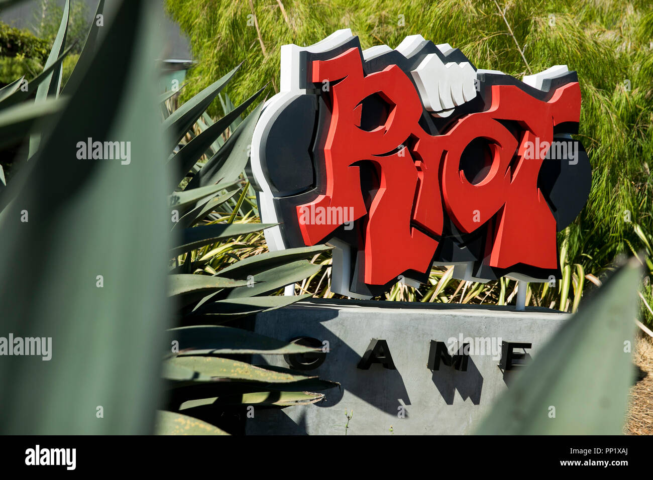 A logo sign outside of the headquarters of Riot Games, Inc., in Los Angeles, California on September 15, 2018. - Stock Image