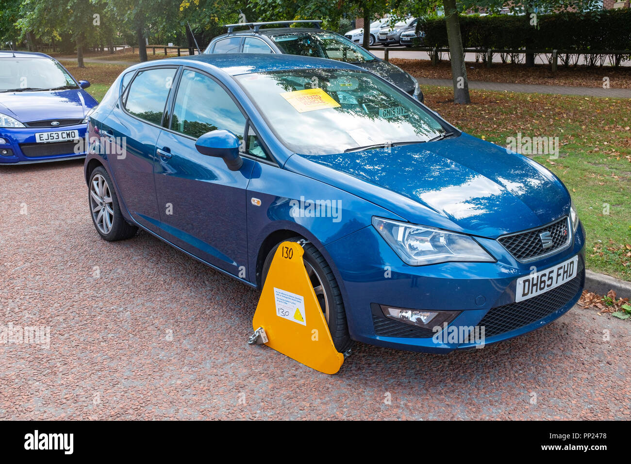 Clamped untaxed vehicle in Crewe Cheshire UK - Stock Image