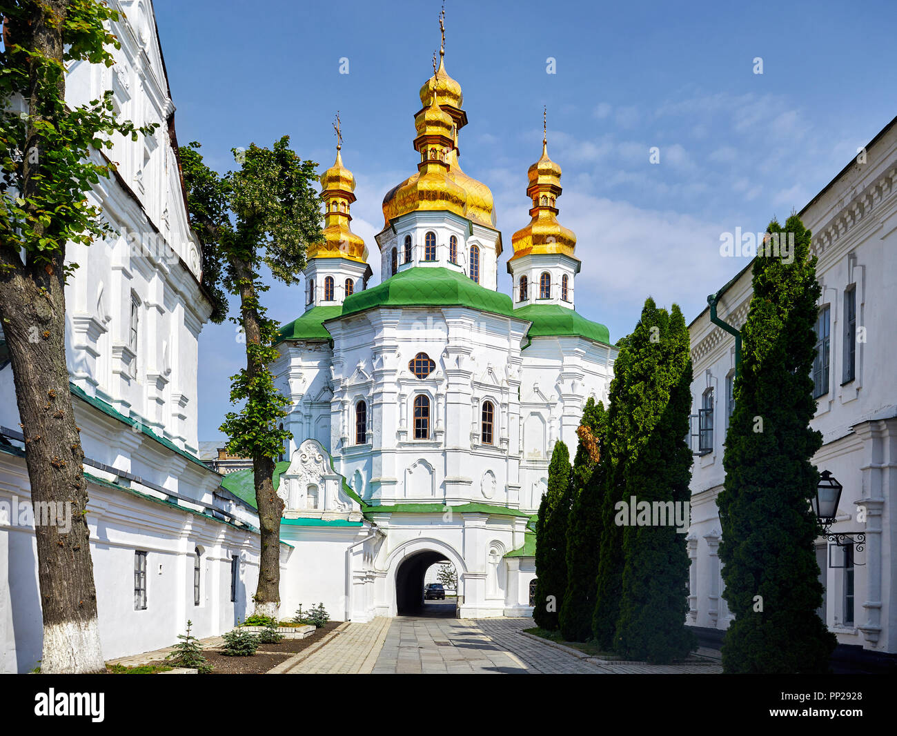Church with golden domes at Kiev Pechersk Lavra Christian complex. Old historical architecture in Kiev, Ukraine - Stock Image