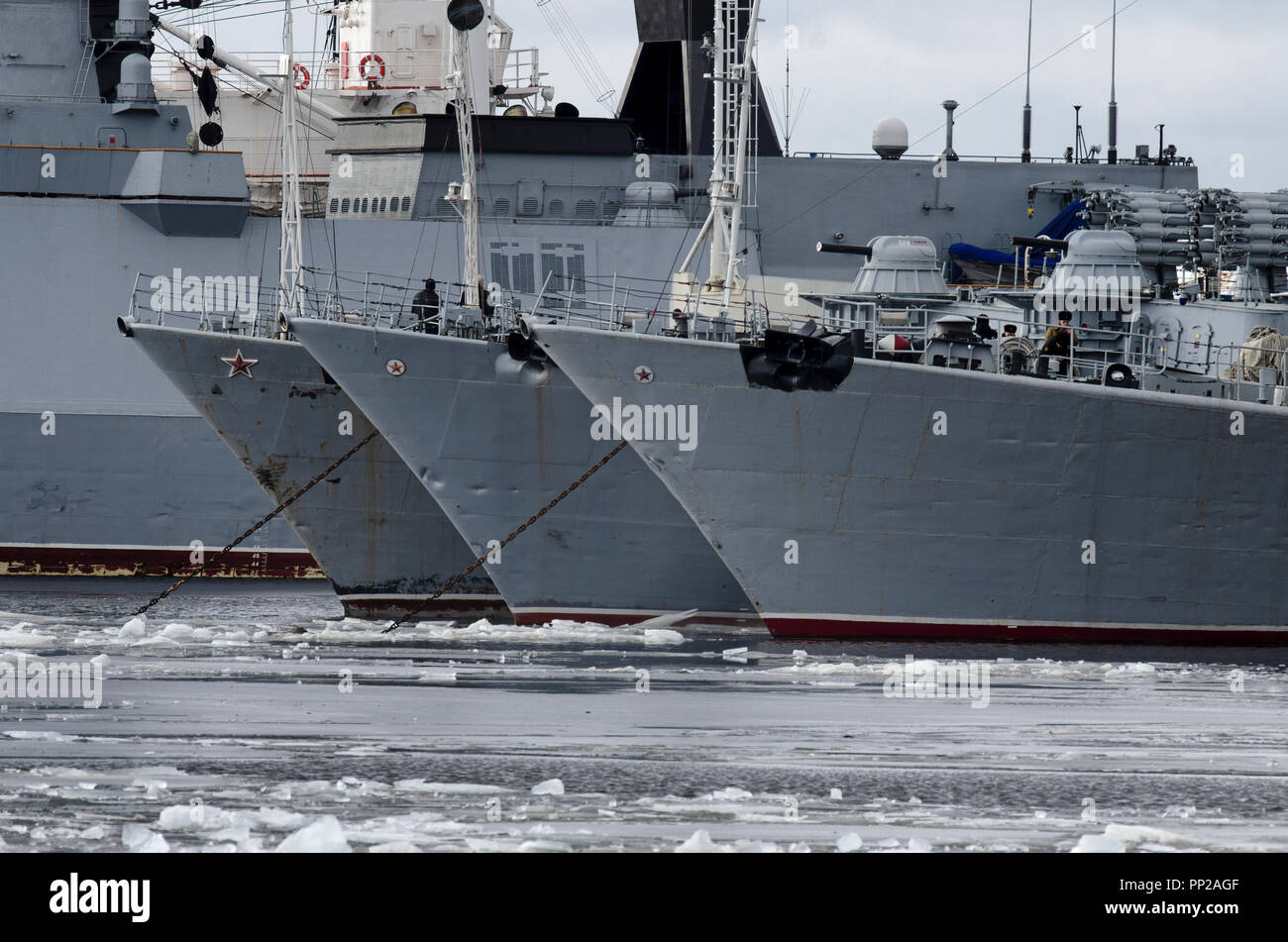 Kronstadt, St. Petersburg, Russia - March 15, 2017: Three patrol ships of the Baltic Fleet with red stars in the ice-cold harbor of Kronstadt - Stock Image