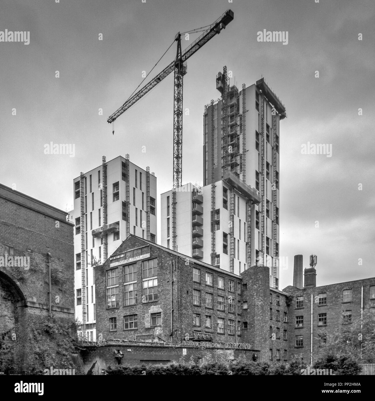 Modern construction and historic architecture together, Manchester, UK - Stock Image