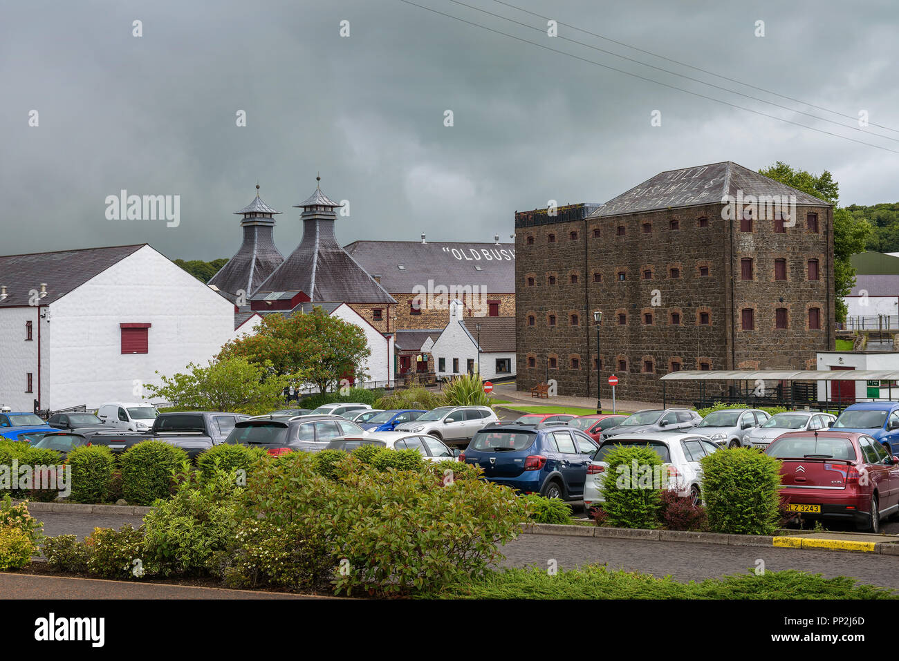 Bushmills, Norther Ireland, United Kingdom - August 6, 2018 : Historic Old Bushmills Distillery known for its irish whiskey blend and a popular touris - Stock Image