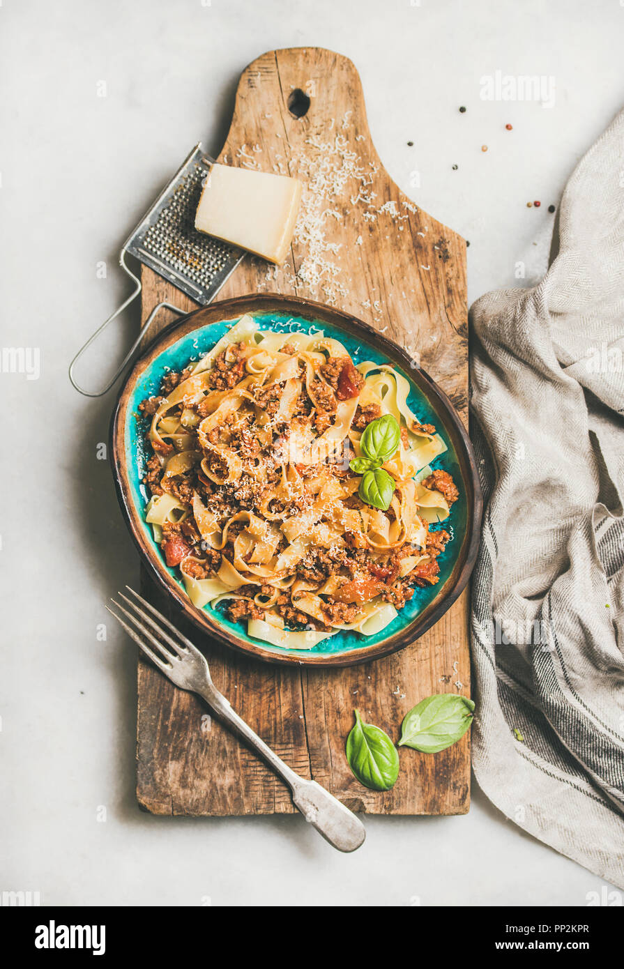 Italian traditional pasta dinner with tagliatelle bolognese, top view - Stock Image