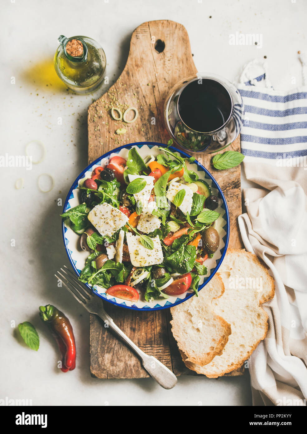 Greek salad with feta cheese, olive oil and red wine - Stock Image