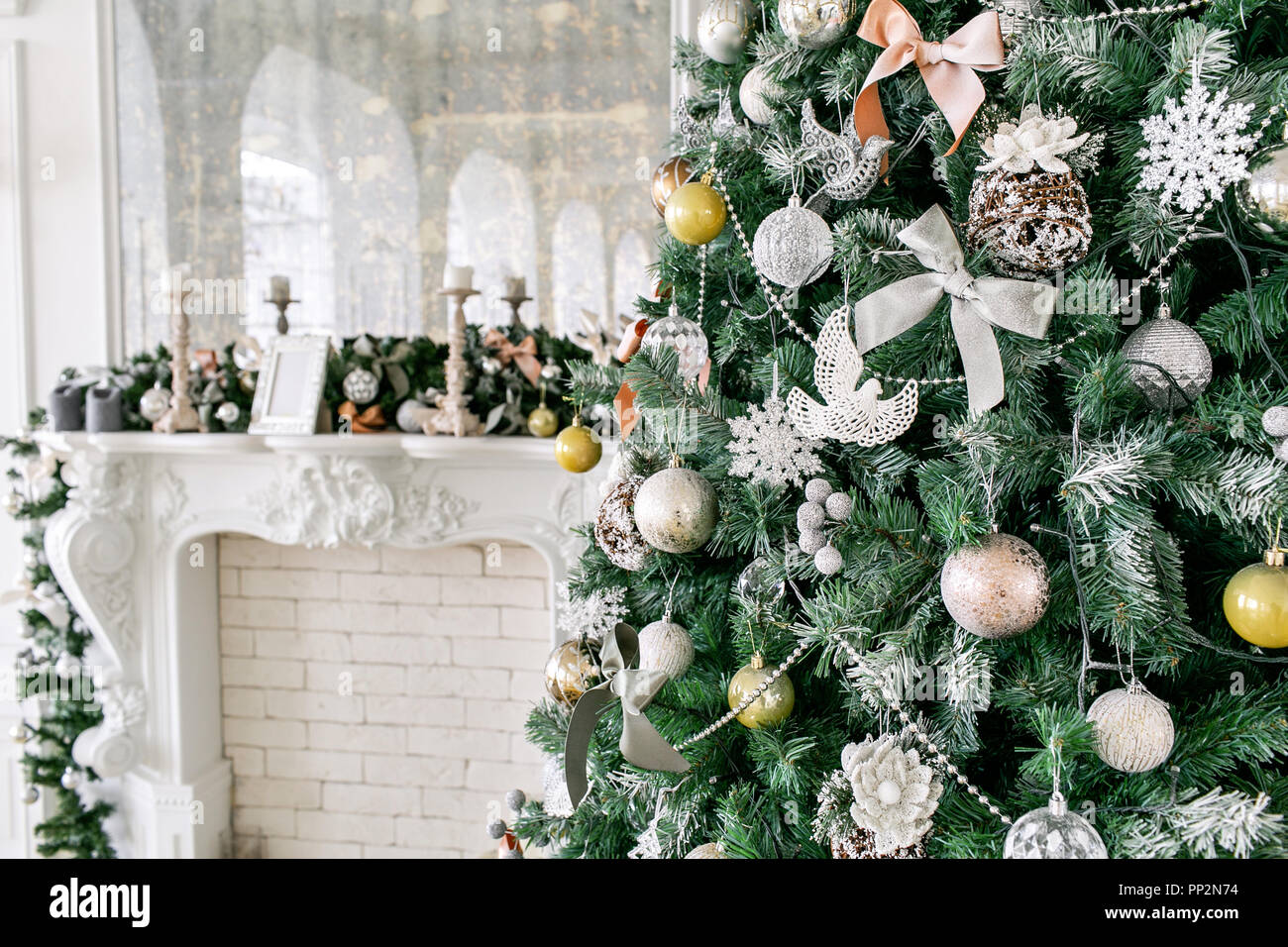 White Fireplace Decorated With Candles And Fir Branches Decorated Christmas Tree Classic Apartments Morning In Hotel Stock Photo Alamy