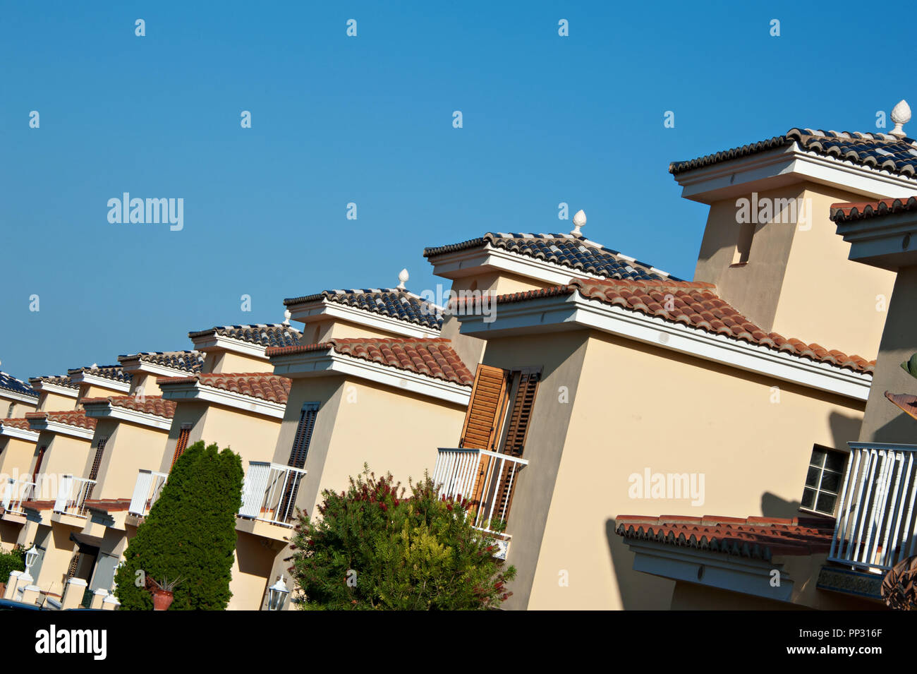A row of properties on a Spanish urbanisation - Stock Image