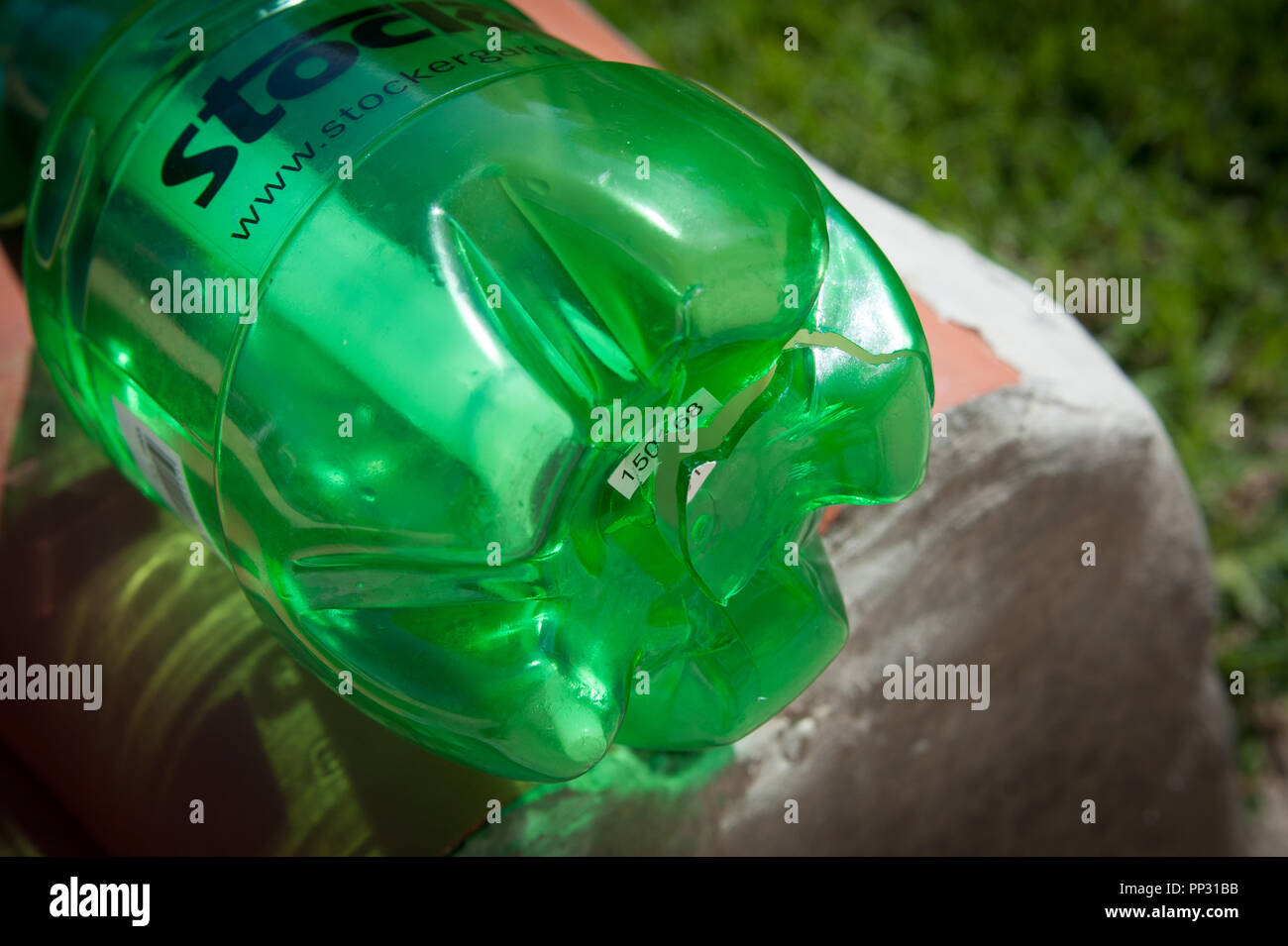 A plant spray which relies on air pressure for spraying plants and trees with insecticides has been over pressurised by the user and has exploded. - Stock Image