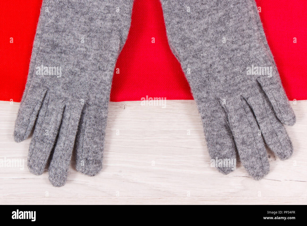 4c372a03a Gray woolen gloves and red shawl for woman on white board, clothing for  using in