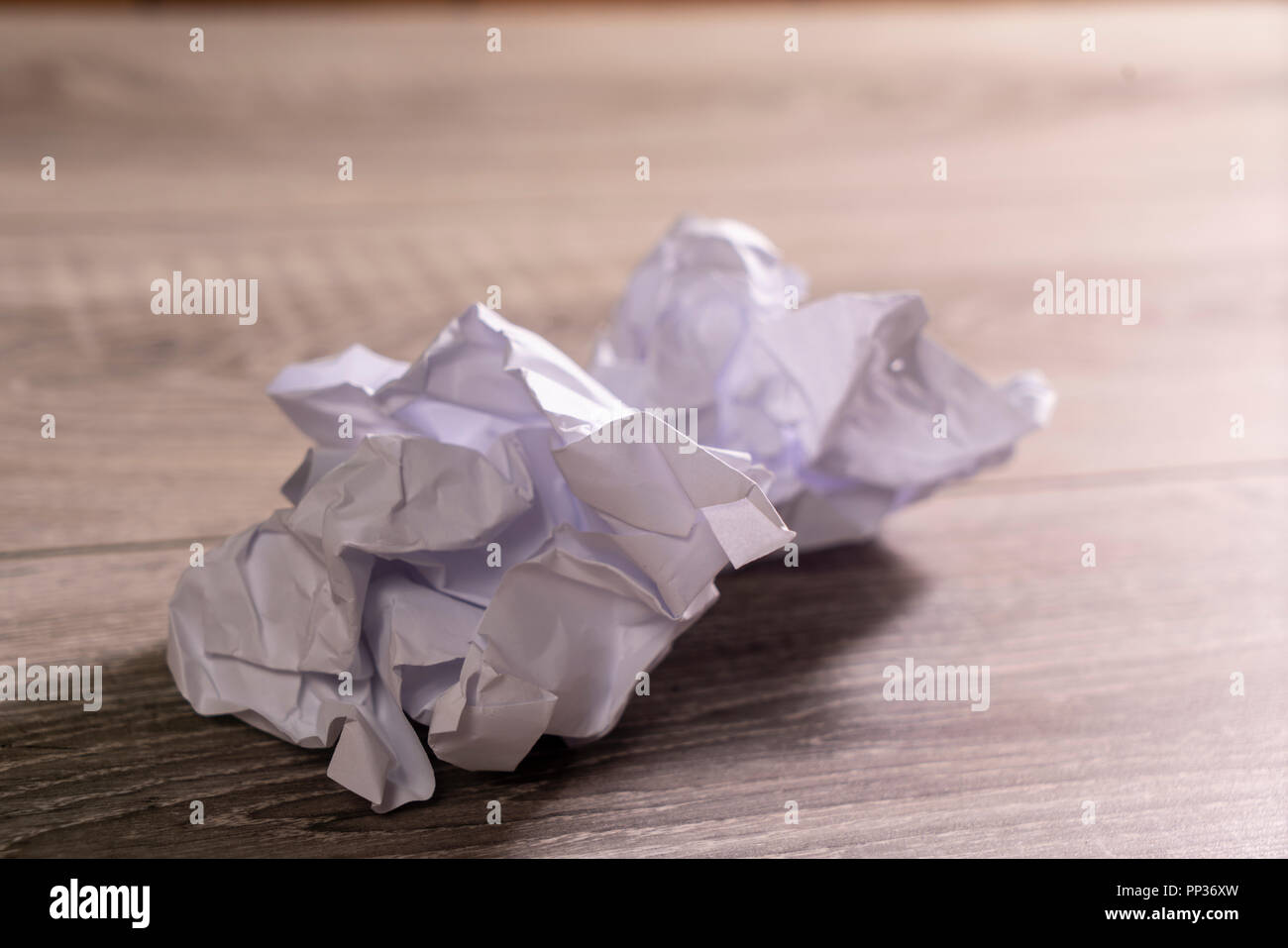 crumpled white sheets of paper - Stock Image