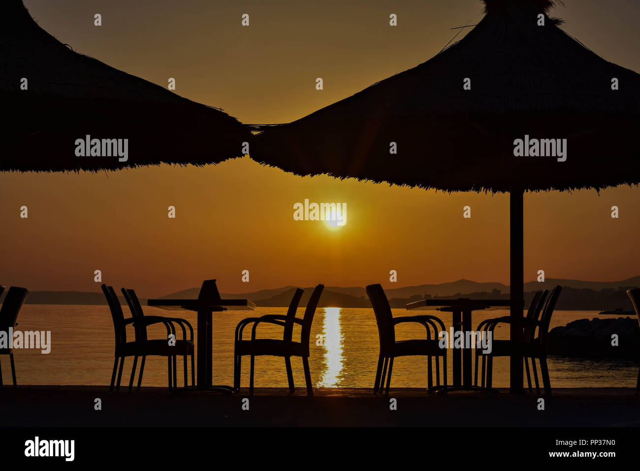 romantic restaurant in the sunset by the sea during golden hour rh alamy com