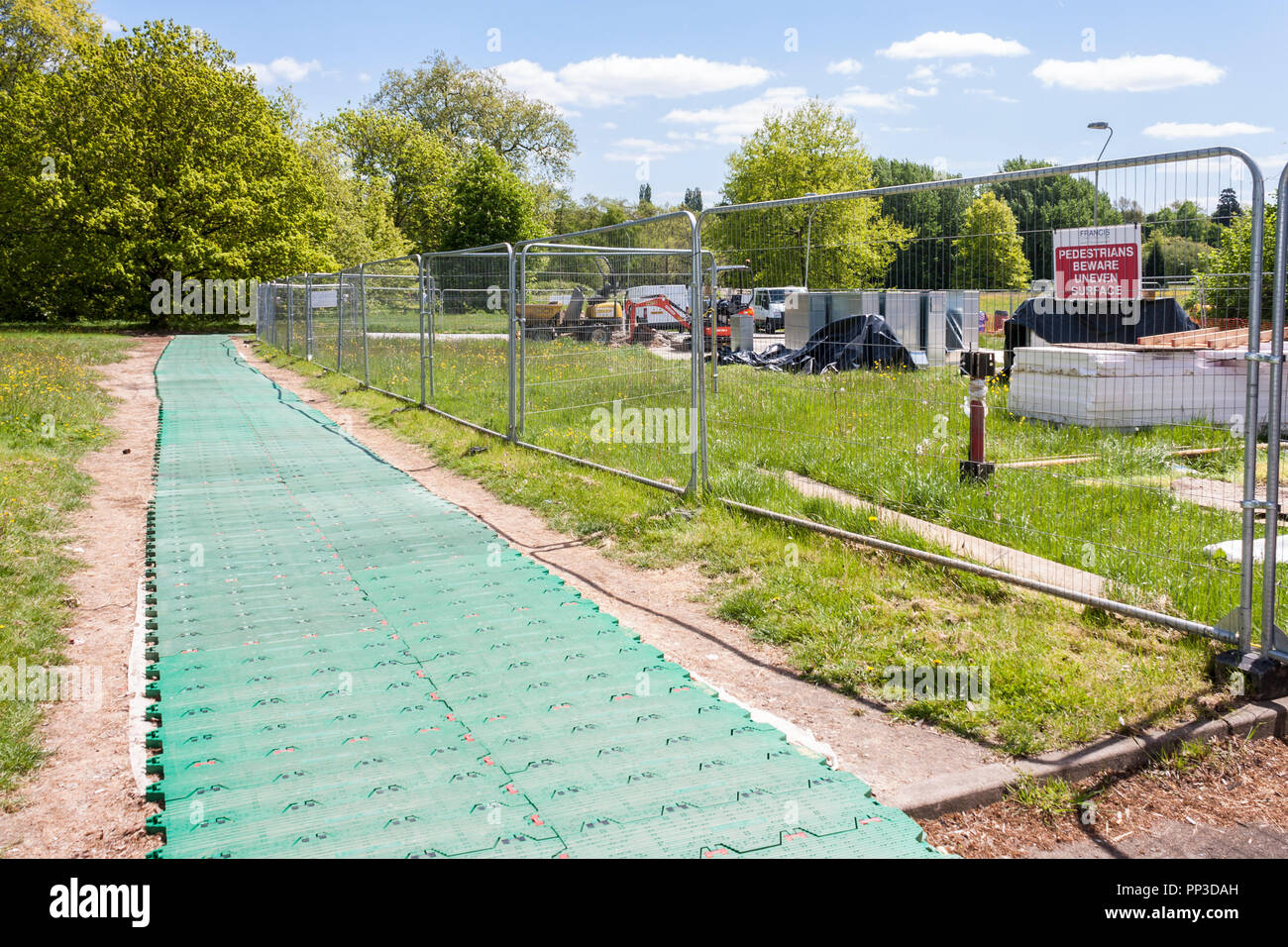 Temporary trackway by Heras fencing securing a construction site - Stock Image