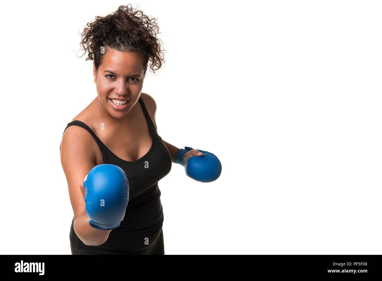 Young pretty black woman with blue boxing gloves working out isolated on a white background - Stock Image