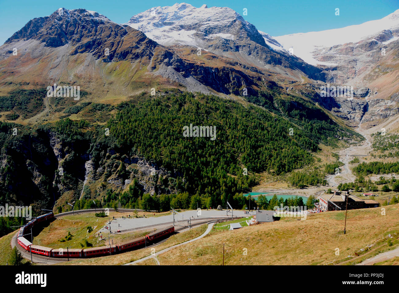 Swiss alps: The train trip from Posciavo in Italy to Bernina-Hospitz in the upper Engadin in canton Graubünden is a tourist hot spot - Stock Image