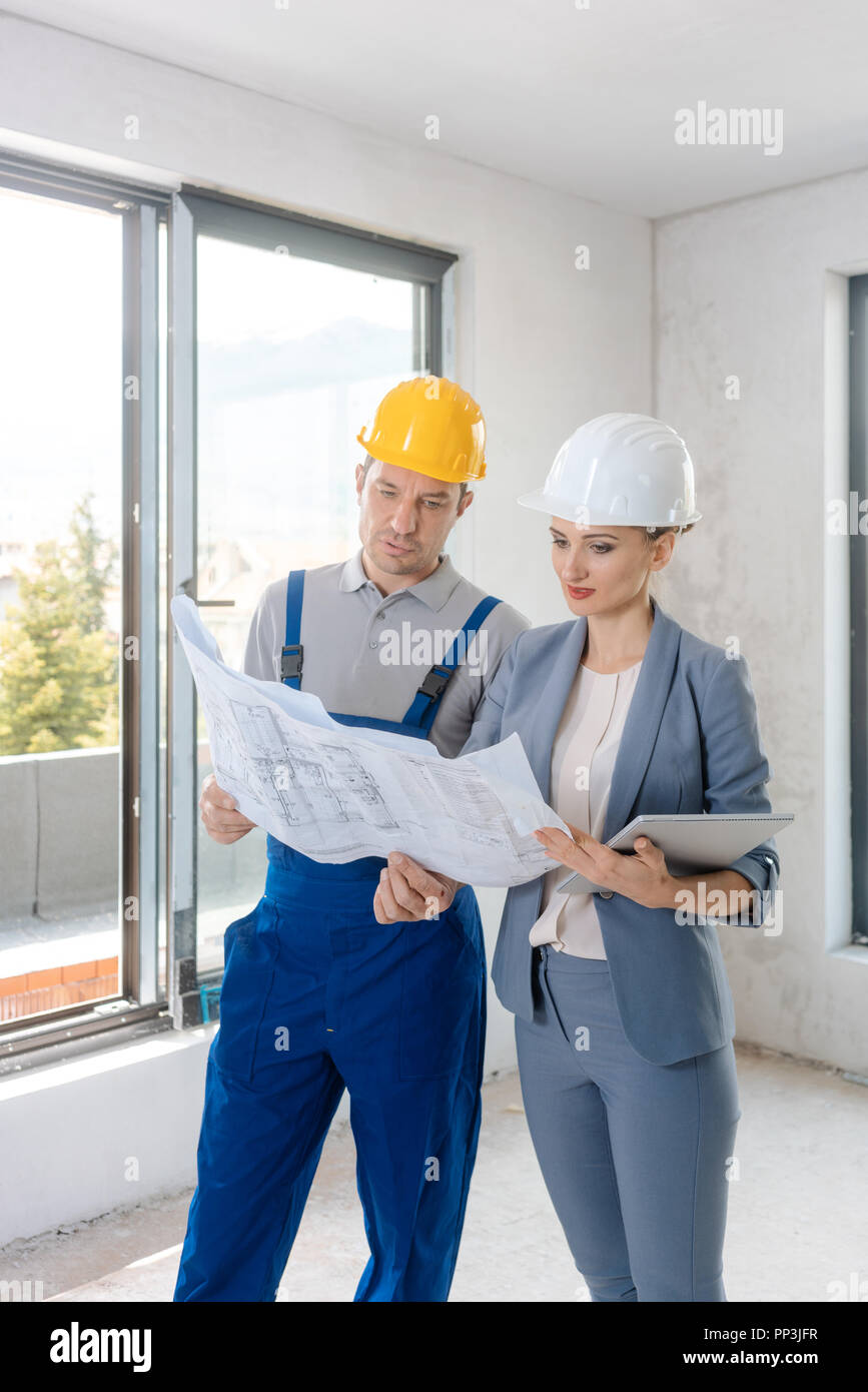 Project owner and construction worker during acceptance  - Stock Image