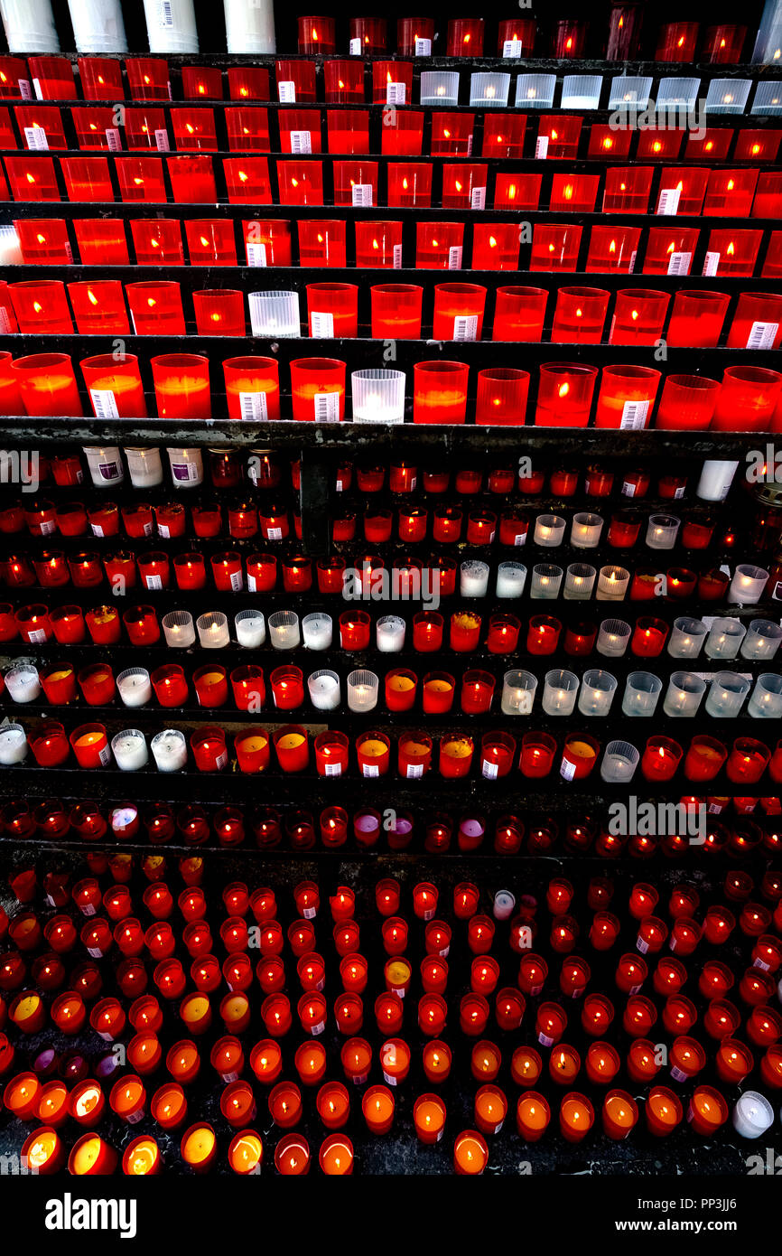 hundreds of red and white candles of praise alight on shelters. - Stock Image