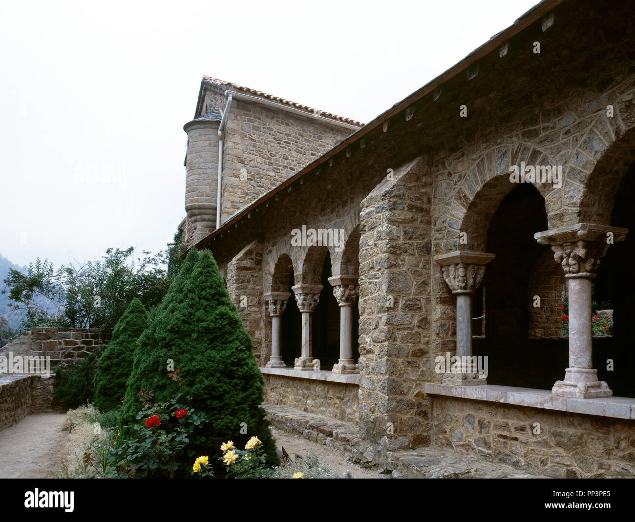 France. Pyrenees-Orientales. Languedoc-Roussillon region. Abbey of Saint-Martin-du-Canigou. Monastery built in 1009, on Canigou mountain. It was built from 1005-1009 by Guifred, Count of Cerdanya in Romanesque style. Architectural detail of the  Cloister. Restoration of 1900-1920. - Stock Image