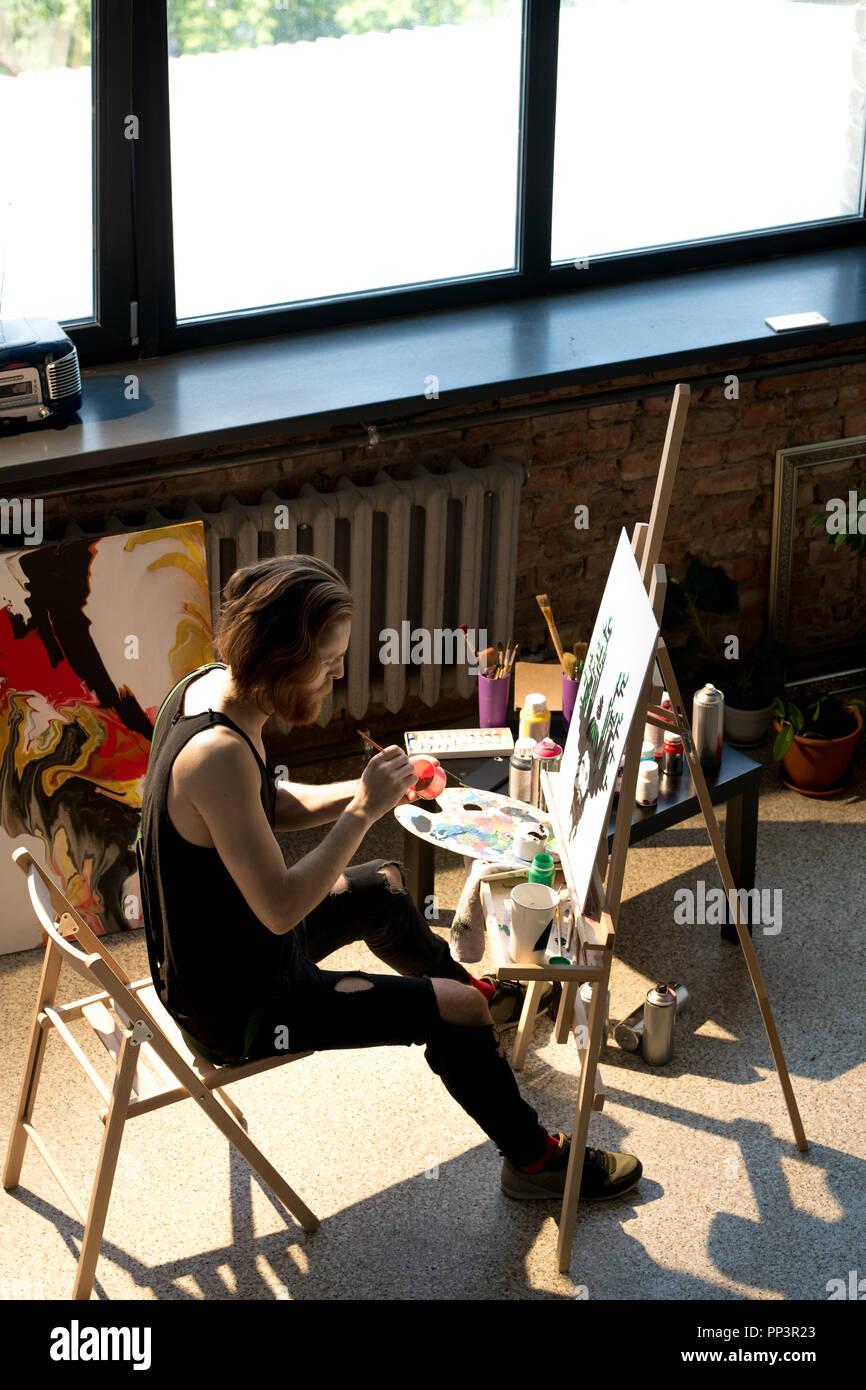 Contemporary Artist in Sunlight - Stock Image