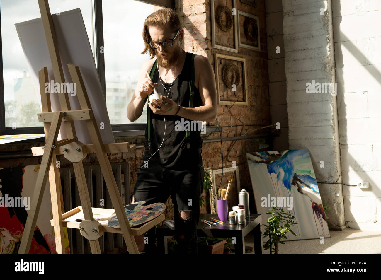 Modern Artist in Workshop - Stock Image
