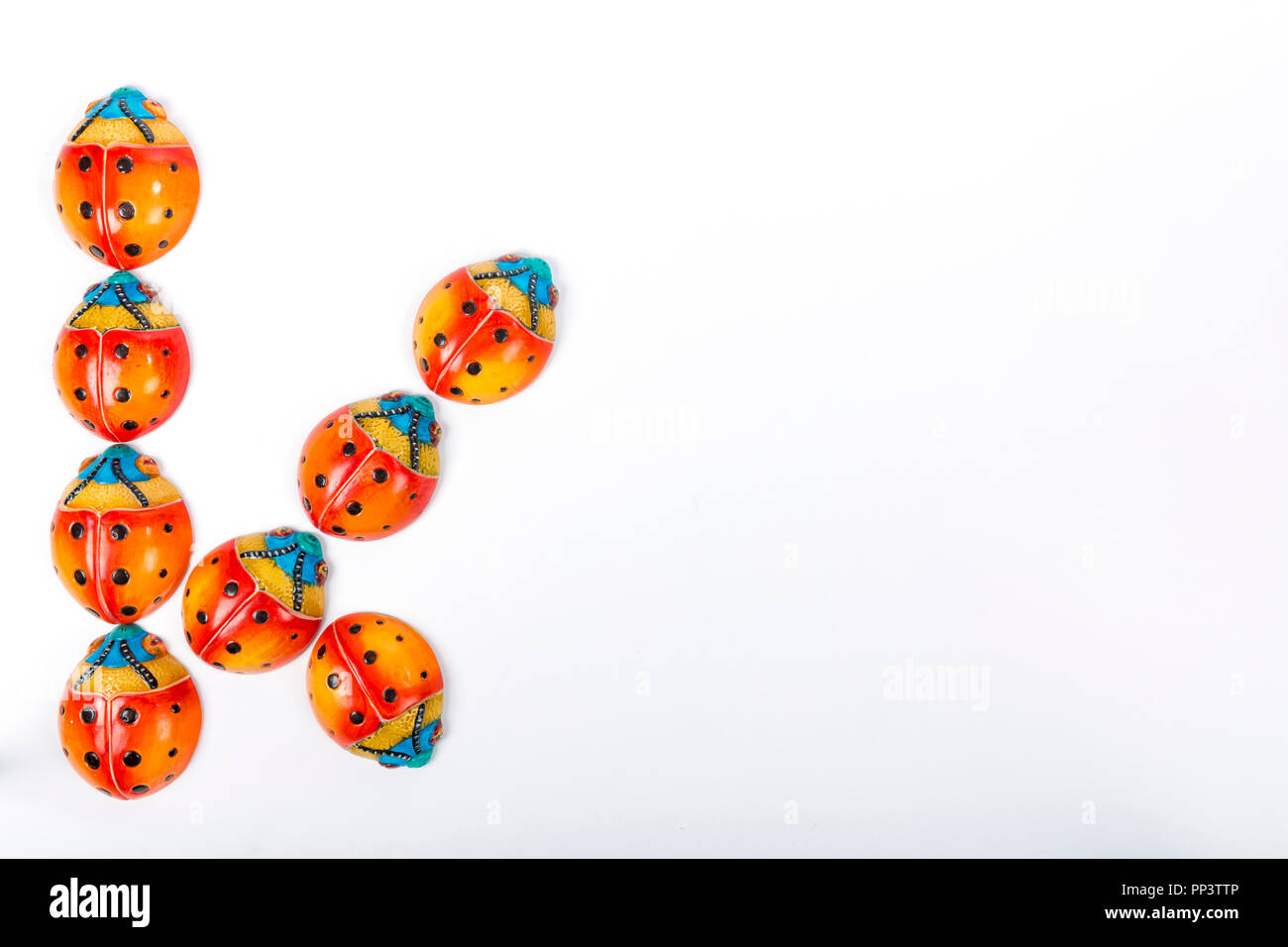 beautiful set of multicolored ladybugs forming an letter K in Mexican ceramics - Stock Image