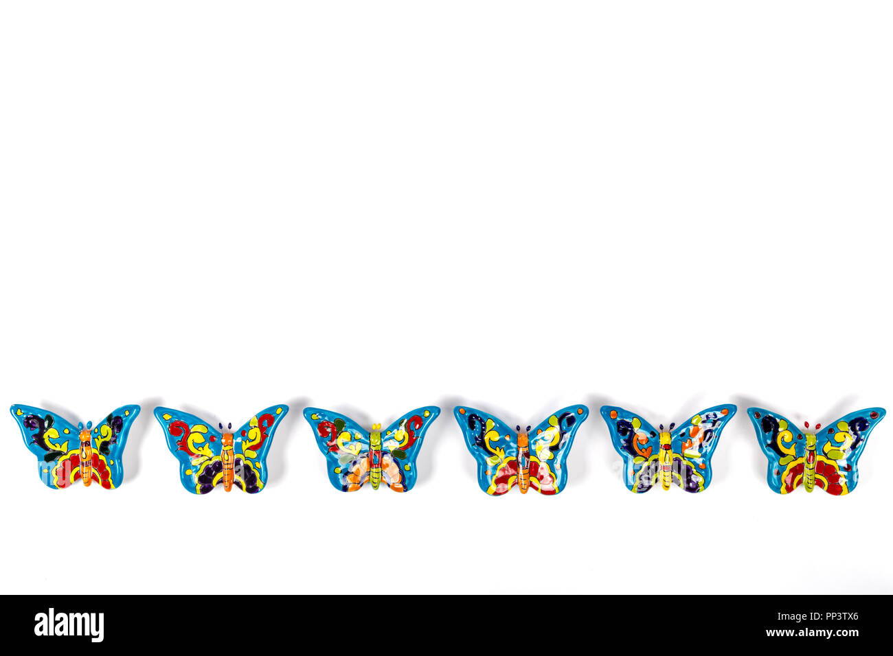 beautiful set of multicolored butterflies in mexican talavera - Stock Image