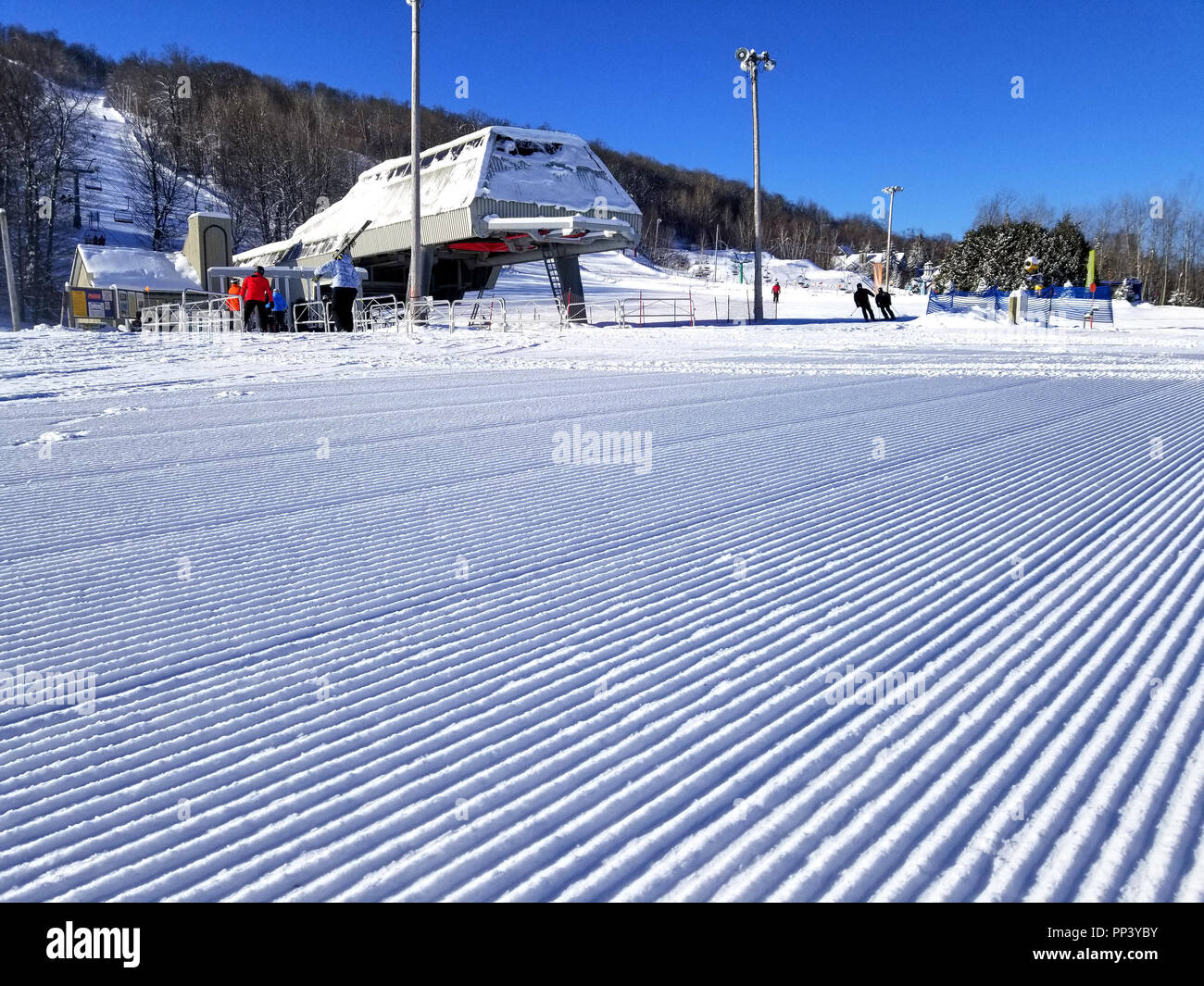 Groomed snow of alpine skiing trails at Saint-Sauveur, Quebec - Stock Image