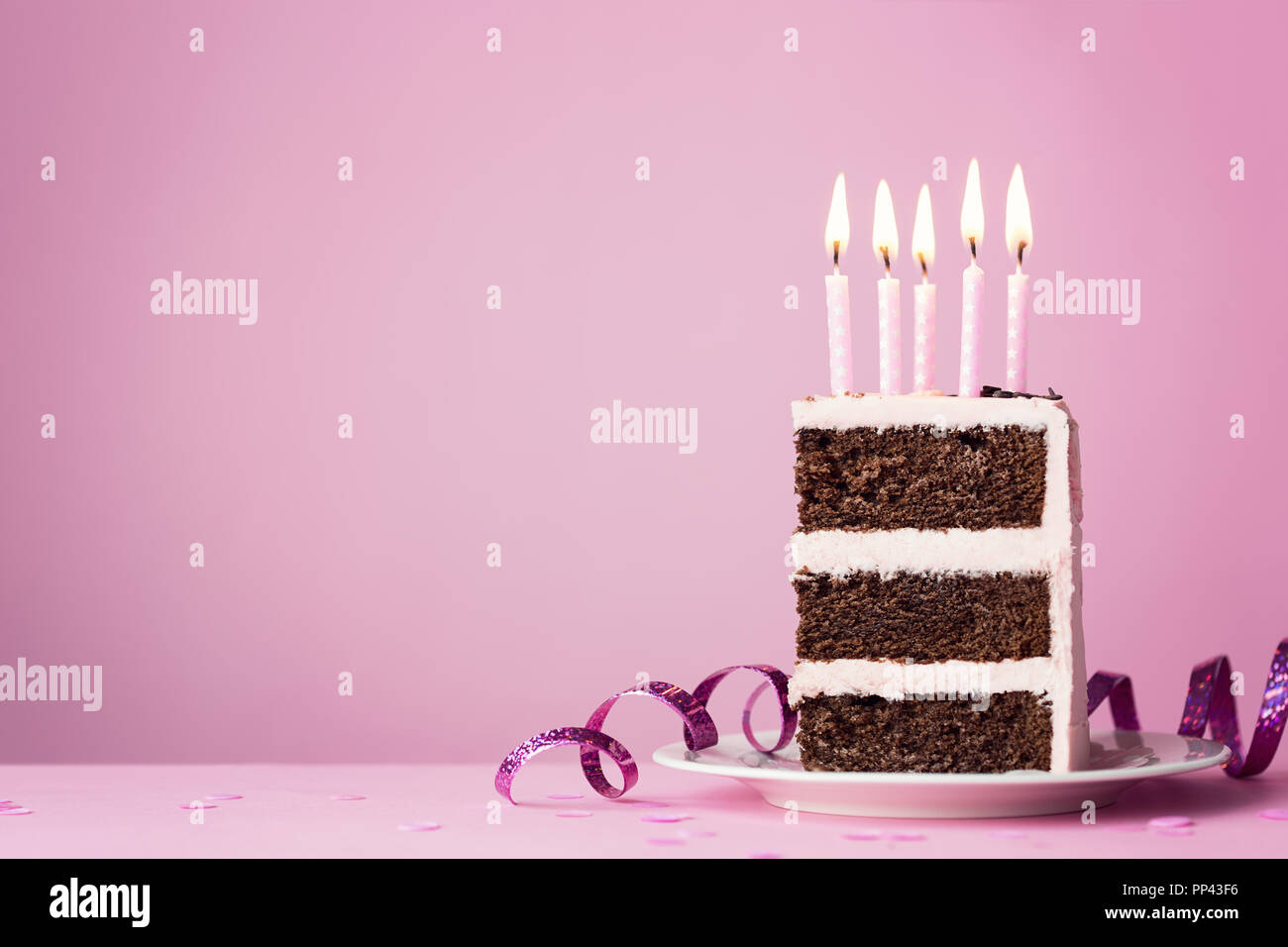 Chocolate Birthday Cake With Pink Frosting And Candles Stock Photo