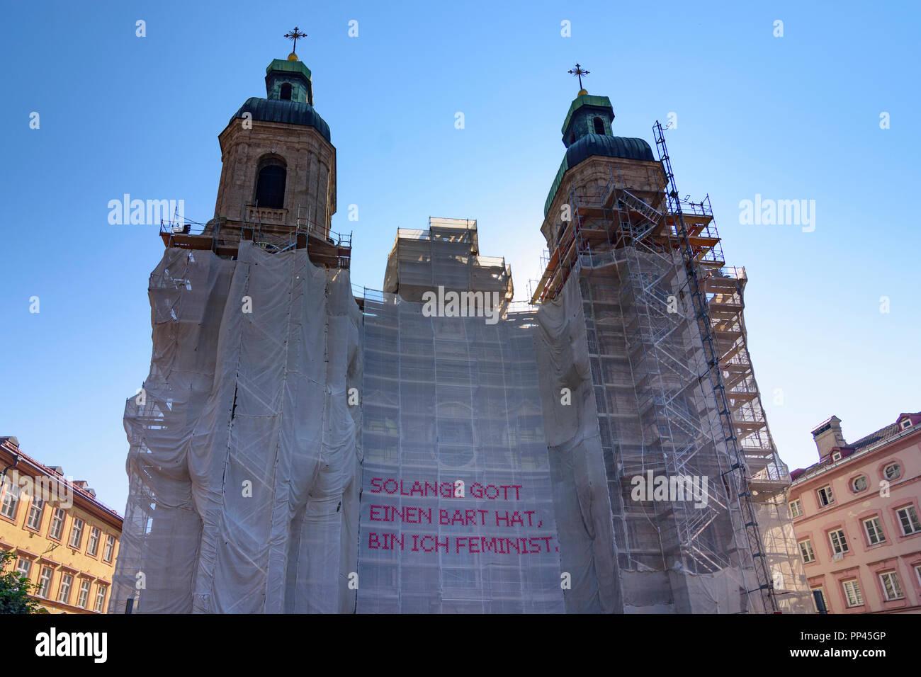 Innsbruck: cathedral Dom, art installation 'Solange Gott einen Bart hat, bin ich Feminist', Region Innsbruck, Tirol, Tyrol, Austria - Stock Image