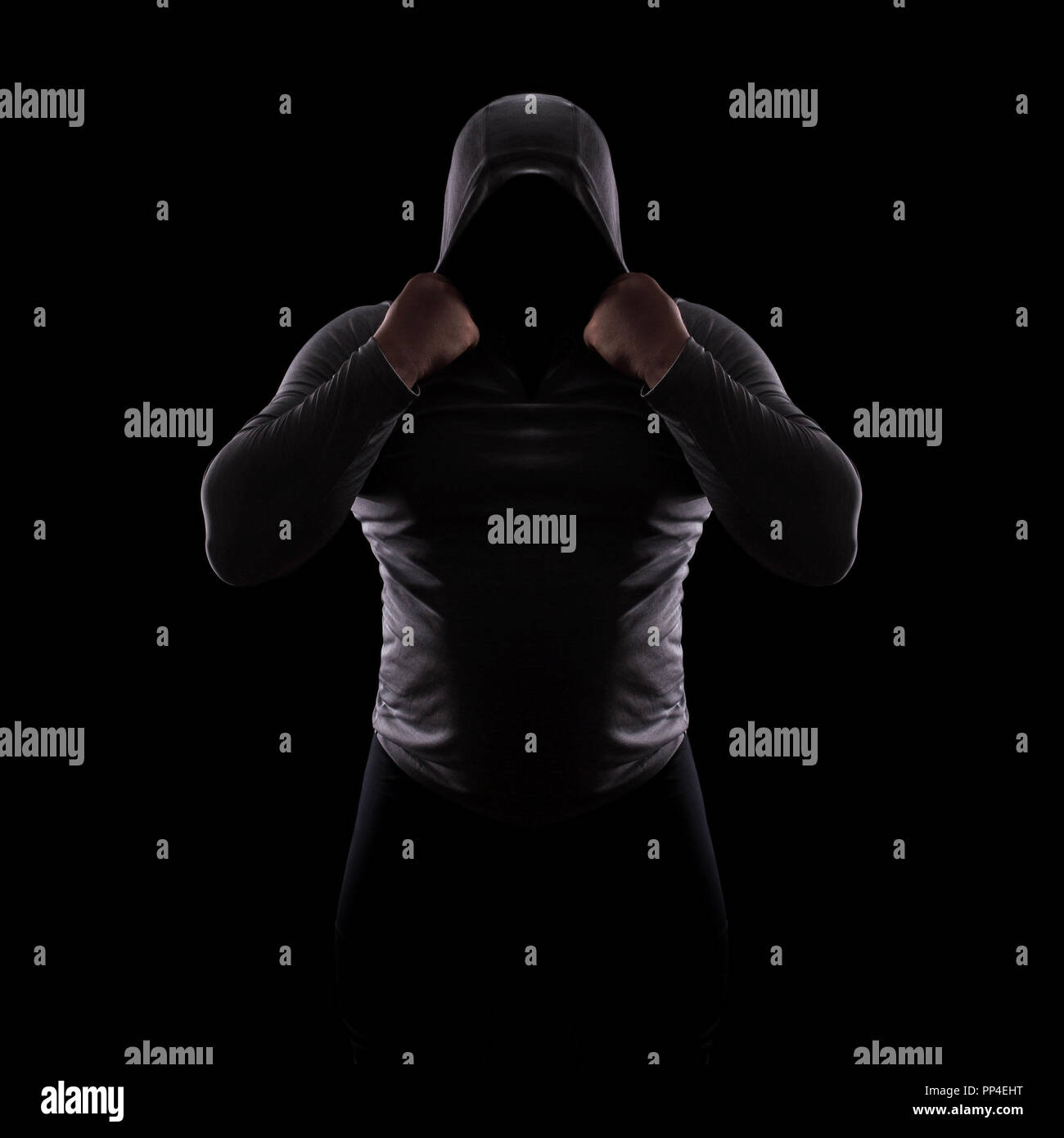 Silhouette of a male fight club in a hood without a face. Stalker silhouette on black background, incognito, anonymous, dangerous man, thug in the dar - Stock Image