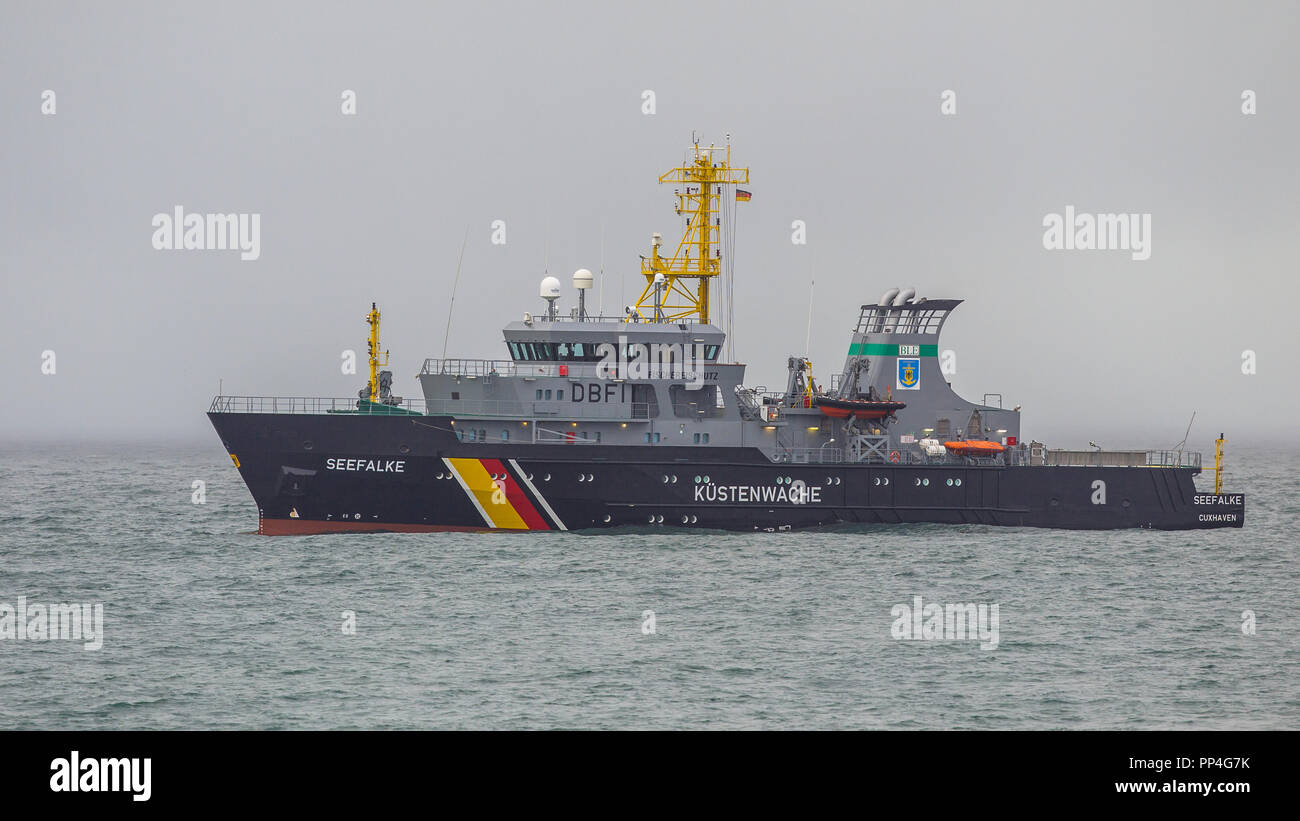 CUXHAVEN, GERMANY- DECEMBER 18, 2016: Modern German coast guard patrolling the north sea and guarding territorial waters on cloudy day - Stock Image