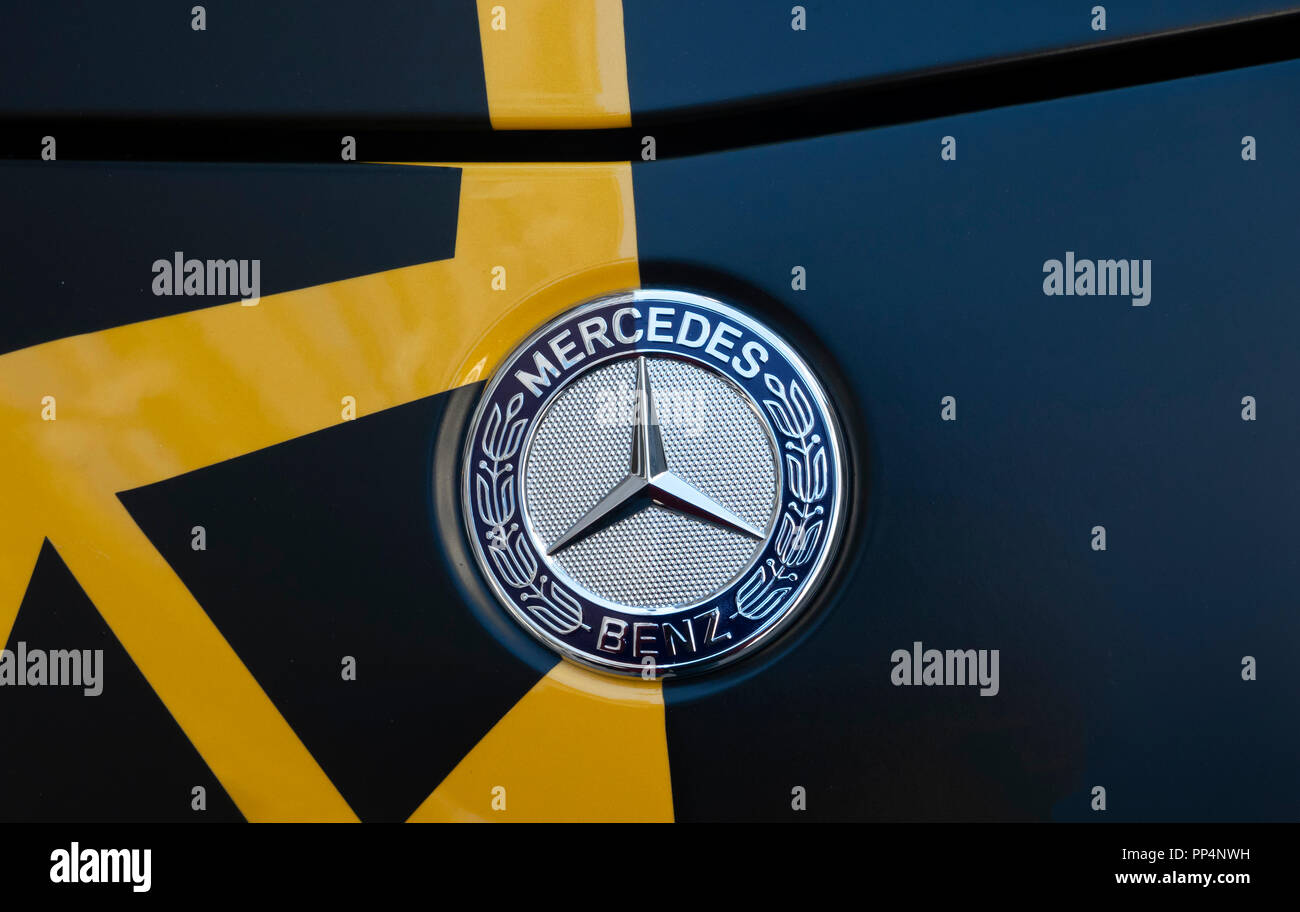 Mercedes Benz AMG sports car wrapped in a special yellow and navy blue color design - Stock Image