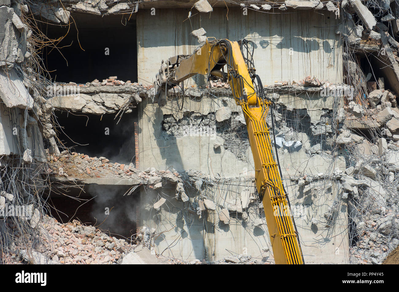 Building demolition and crashing by machinery for new construction. Industry. Stock Photo