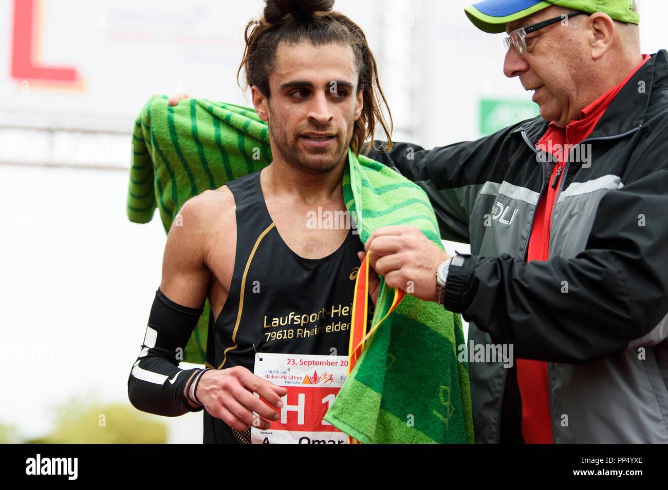 Karlsruhe, Germany. 23rd Sep, 2018. Winner half marathon Omar Tareq (TuS Loerrah Stetten/Laufsport Heinz). GES/Athletics/Baden-Marathon, 23.09.2018 | usage worldwide Credit: dpa/Alamy Live News - Stock Image