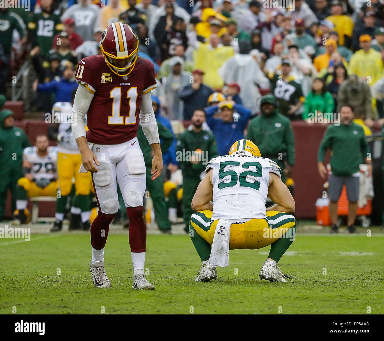 Landover, MD, USA. 23rd Sep, 2018. Green Bay Packers LB #52 Clay Matthews is called for roughing the passer during this attempted sack of Washington Redskins QB #11 Alex Smith during a NFL football game between the Washington Redskins and the Green Bay Packers at FedEx Field in Landover, MD. Justin Cooper/CSM/Alamy Live News - Stock Image