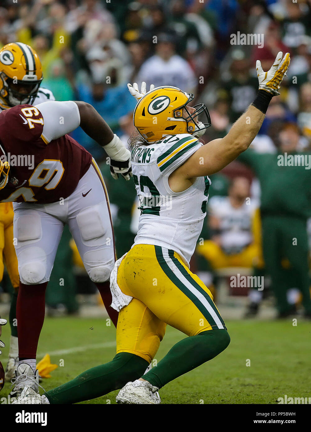 Landover, MD, USA. 23rd Sep, 2018. Green Bay Packers LB #52 Clay Matthews protests a roughing the passer penalty during a NFL football game between the Washington Redskins and the Green Bay Packers at FedEx Field in Landover, MD. Justin Cooper/CSM/Alamy Live News - Stock Image