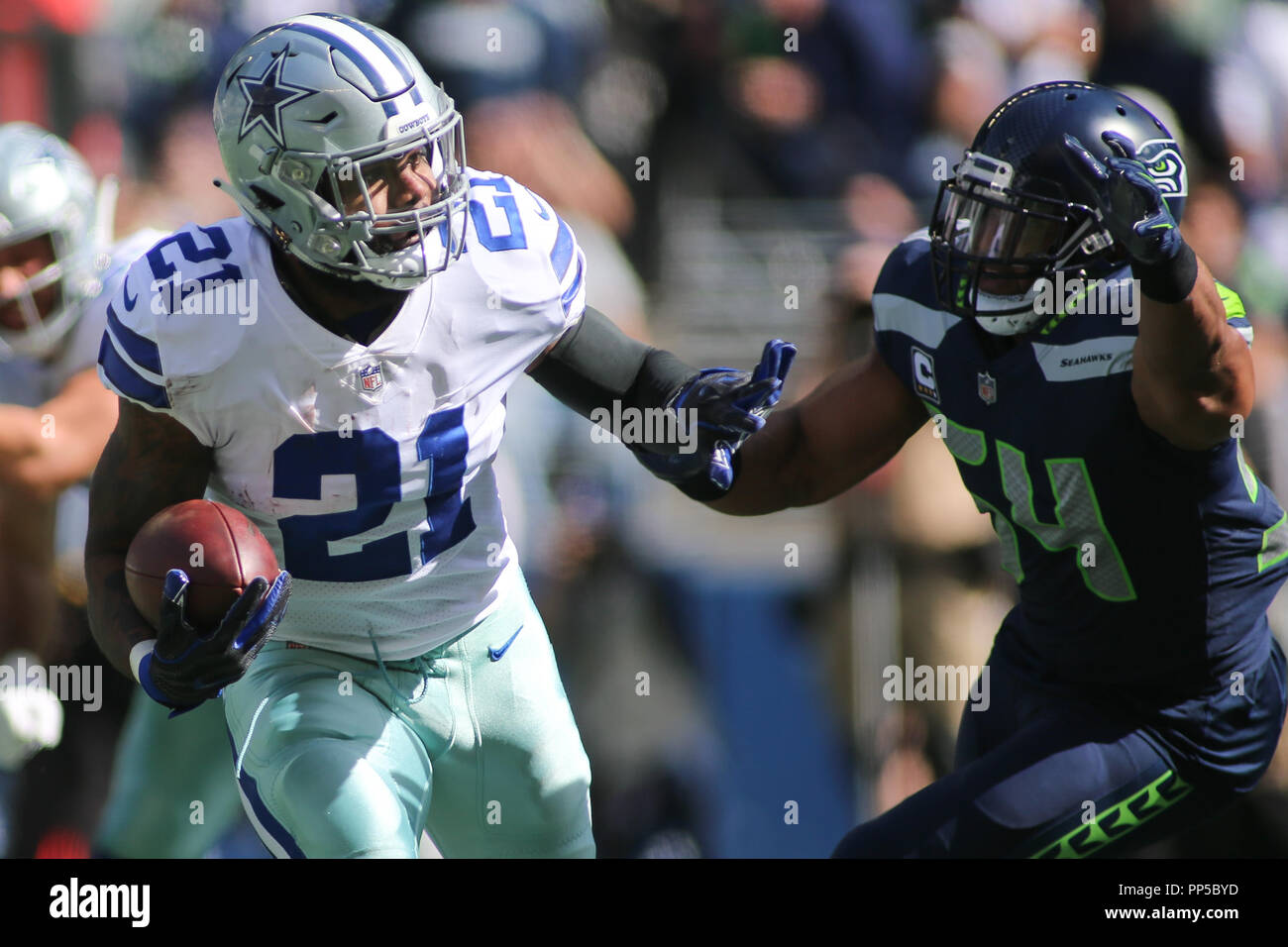 Seattle Seahawks linebacker Bobby Wagner (54) tries to bring down Dallas  Cowboys running back Ezekiel Elliott (21) during a game between the Dallas  Cowboys ... f2ce61486